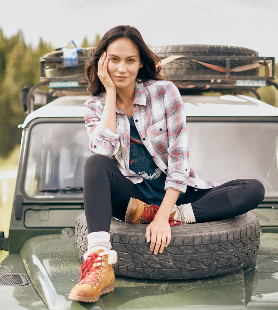 Female model in flannel shirt.